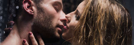 Photo pour Panoramic picture of an erotic couple kissing while taking a shower together - image libre de droit