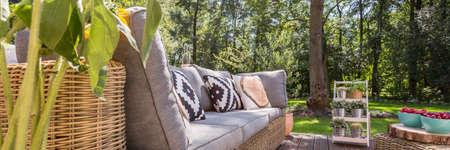 Foto de Cosy veranda with garden furniture and view of a garden - Imagen libre de derechos