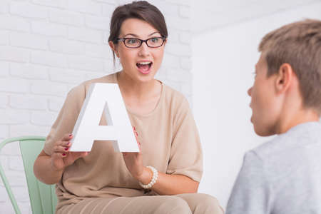 Photo for Shot of a speech therapist during a session with a little boy - Royalty Free Image