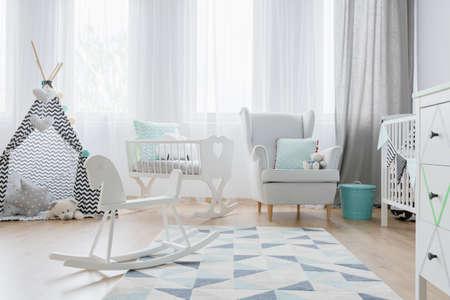 Foto für Shot of a bright baby's room with a little tent and a rocking horse - Lizenzfreies Bild