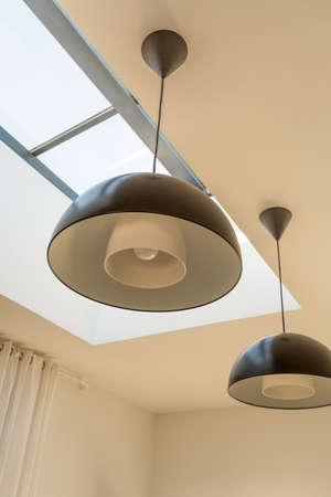Foto de Modern minimalist black overhead light on ceiling with window - Imagen libre de derechos