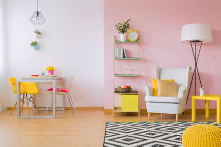 Photo pour Pink living room with white and yellow furniture - image libre de droit