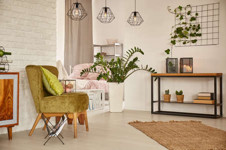 Photo for White home interior with green armchair and brick wall - Royalty Free Image
