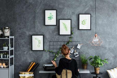 Photo pour Room area with woman working at the desk - image libre de droit