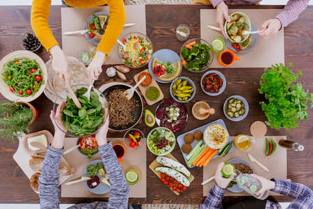 Photo pour Various vegetarian food lying on rustic wooden table - image libre de droit
