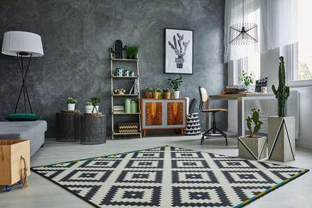 Photo pour Grey flat with black and white pattern carpet - image libre de droit