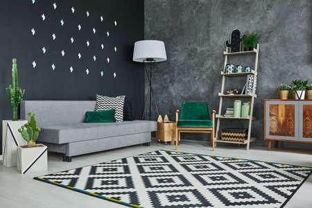Foto de Grey room with blackboard wall, cactus and sofa - Imagen libre de derechos
