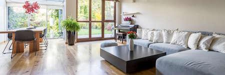 Photo pour Villa interior with large sofa, table, chairs and balocny - image libre de droit