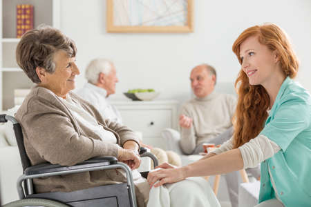 Photo for Nurse taking care of senior woman on wheelchair - Royalty Free Image