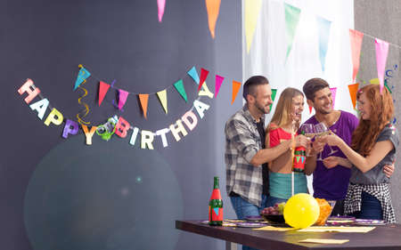 Photo pour Pretty happy girl and her friends on her birthday party - image libre de droit