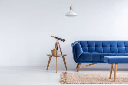 Foto de Bright apartment with blue sofa, bench, rug, lamp and table - Imagen libre de derechos