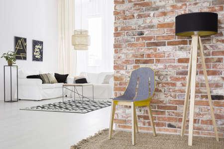 Foto de Trendy loft with brick wall and white living room - Imagen libre de derechos