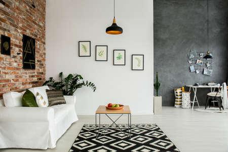 Foto de Loft interior with open living room and simple home office - Imagen libre de derechos