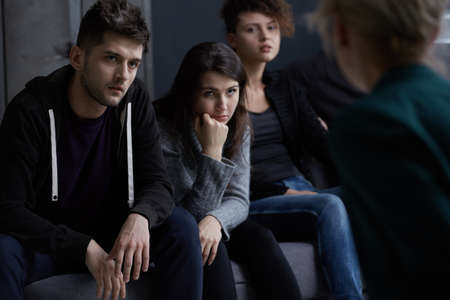 Foto de Young people addicted to drugs participating in group therapy - Imagen libre de derechos