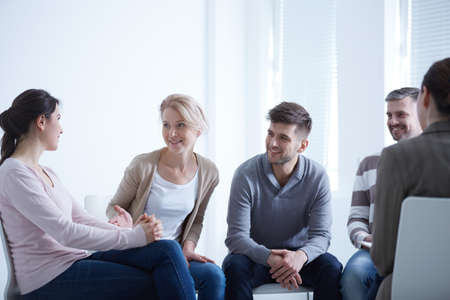Photo for People talking in circle during AA group meeting - Royalty Free Image