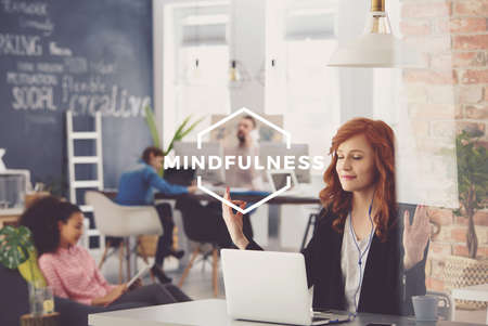 Photo for Young woman working in agency, relaxing during work, mindfulness - Royalty Free Image