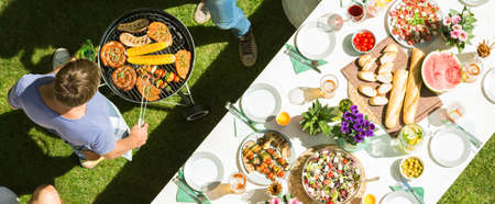 Photo pour Party at the open air with table full of food and grill - image libre de droit