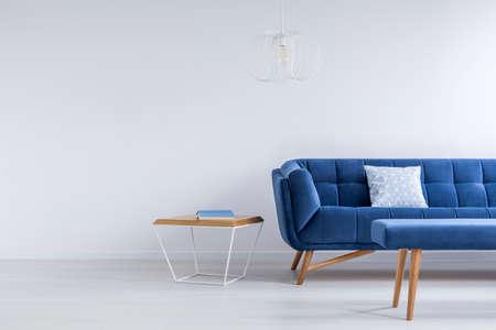 Photo pour Blue sofa and bench in white trendy lounge - image libre de droit