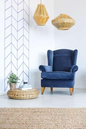 Photo pour White room with decorative wall tape, blue armchair, lamp, pouf - image libre de droit