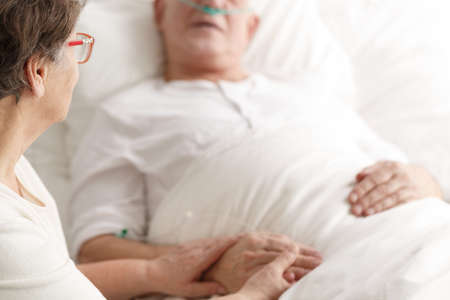 Photo pour Loving wife caring about dying ill spouse before his death - image libre de droit
