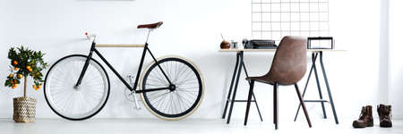 Foto de Stylish minimalist workspace in a classic interior for man - Imagen libre de derechos