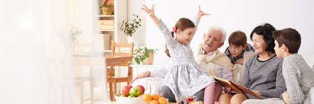 Photo pour Happy grandparents taking care of their young grandchildren - image libre de droit