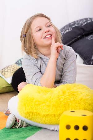 Foto de Cute little girl smiling at teacher during the educational classes - Imagen libre de derechos