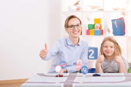 Foto de Smart little genius learning traffic regulations with young female teacher - Imagen libre de derechos