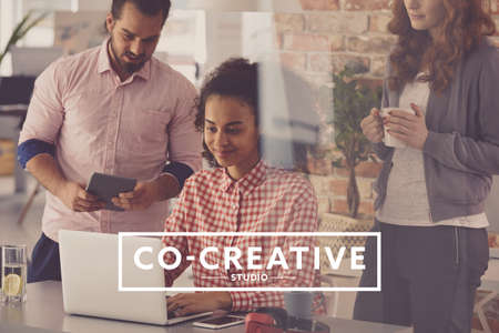 Photo for Creative team surfing the internet during coffee break at coworking office - Royalty Free Image