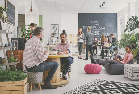 Foto de Marketing agency workers having coffee break at comfortable relax zone - Imagen libre de derechos