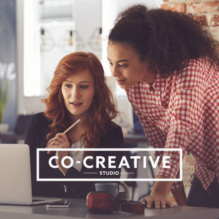 Photo for Young focused women creating a business plan in co-creative studio - Royalty Free Image