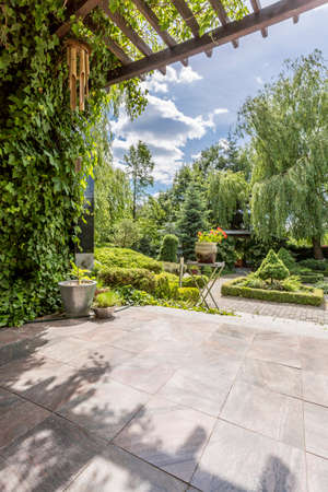 Photo for Exterior view of a luxurious villa garden, terrace and patio - Royalty Free Image
