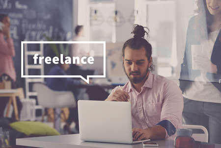 Photo for Young freelance designer discussing with coworkers in blurred background - Royalty Free Image