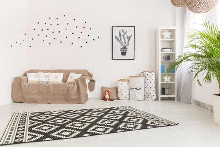 Photo pour Adorable baby room in minimalistic design and touches of color - image libre de droit