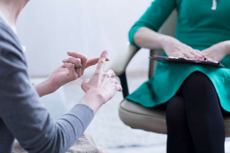 Photo for Close-up of woman's hands explaining the problems to psychotherapist - Royalty Free Image
