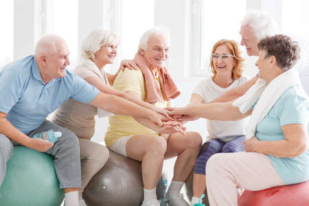 Photo for Happy active senior people congratulations each other for workout - Royalty Free Image