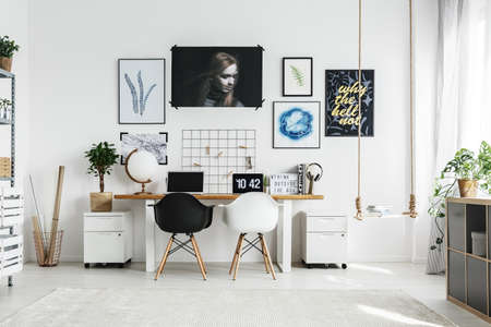 Photo for Creative home office with double desk and two chairs - Royalty Free Image