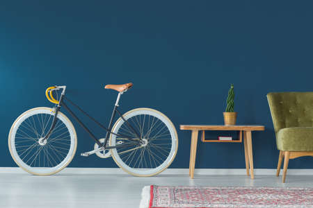 Photo for Stylish bike and vintage furniture in modern interior - Royalty Free Image