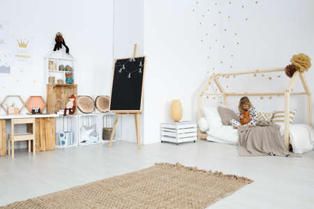 Photo pour Spacious white girl's room with handmade toys and furniture - image libre de droit