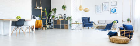 Photo for Up-to-date deco of white and navy blue spacious apartment - Royalty Free Image
