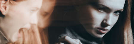 Foto de Troubled woman hiding her feelings of frustration and pain - Imagen libre de derechos