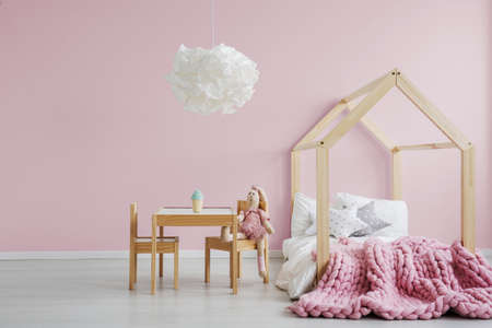 Photo pour Girly scandi room with wooden house bed - image libre de droit