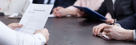 Photo for Man holding his CV during job interview in the office - Royalty Free Image