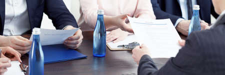 Photo for Water bottles standing on a table during recruitment review - Royalty Free Image