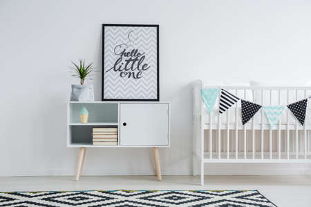 Foto de Cute minimalism in in nursery with vintage furniture - Imagen libre de derechos