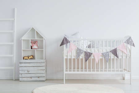 Photo pour White, vintage baby furniture set in scandi room - image libre de droit