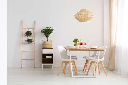 Foto de Bright minimal dining room in slow life trend - Imagen libre de derechos