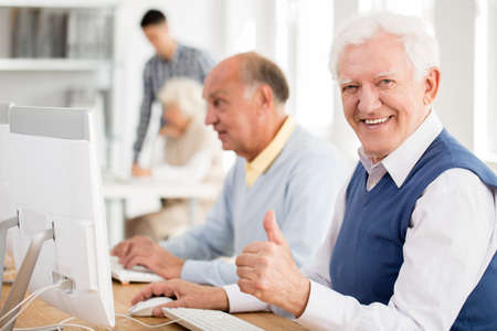Photo for Happy grandpa enjoys learning about modern technology - Royalty Free Image