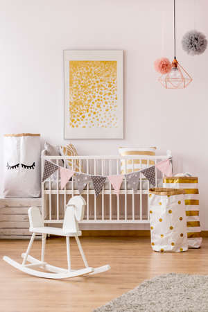 Photo pour Modern newborn corner with golden decor and glitter dots poster - image libre de droit