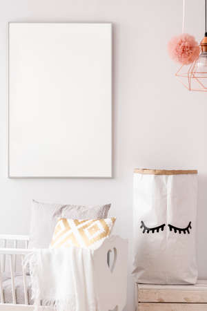 Photo pour Baby nursery with white poster mockup and storage paper bag - image libre de droit